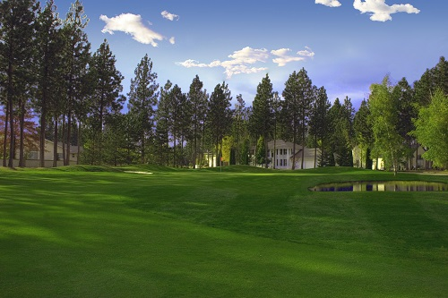 /></a><br /><br /></p> <p>Set atop the hills overlooking Post Falls, The Highlands Golf Course peeks out from among its tall pines and gorgeous North Idaho Scenery. The pristine 18-hole course is nestled within the beautiful homes of the Highland Park Estates and offers a challenge to golfers of all skills. The atmosphere is warm and welcoming and is the perfect place to experience true Northwest golf with friends. One of the many amenities offered at The Highlands is our practice facility - arguably the finest in the area, complete with a full size grass driving range and large chipping, pitching and putting areas. We offer lessons for all ages led by advanced PGA instructor and Head Pro - Mark Poirier. The Highlands also offers numerous leagues for group fun - Wednesday Night Men